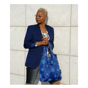Woman carrying chic Winter Design Group eco-tote in blue