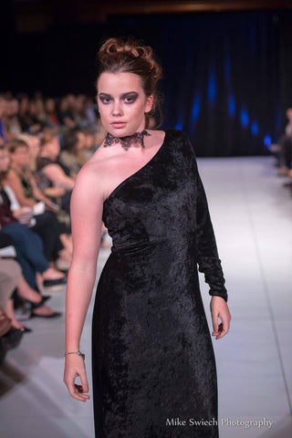 Maddie Pond wears this single-sleeved crushed velvet gown during the Atlantic Fashion Week in October 2017