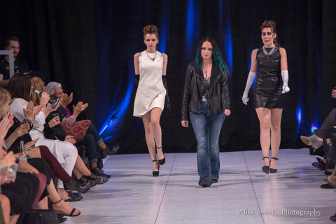 LeeAnn Dussault walking down the runway with her two faux shifts worn by beautiful models.