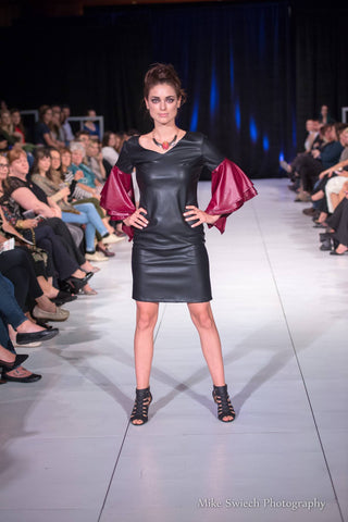 One of East Coast Couture's favourite models, Cindy Therrien, traveled to Halifax to walk the runway in this sleeved faux leather shift.