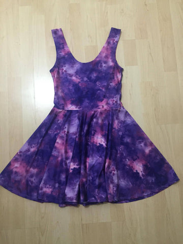 Flay lay of a new skater dress, made from stretchy polyester nylon galaxy print fabric