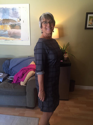 The honorable Cathy Rogers is pictured here wearing the knit grey tartan dress during a fitting. This dress is similar to our current grey tartan dresses available in our store.