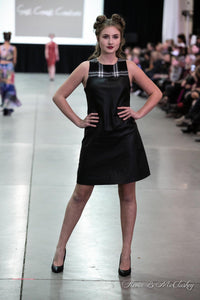 Model Leigha Eldridge wearing East Coast Couture's tartan faux leather shift at the 12th annual Atlantic Fashion week in Halifax, Nova Scotia, October 2018.