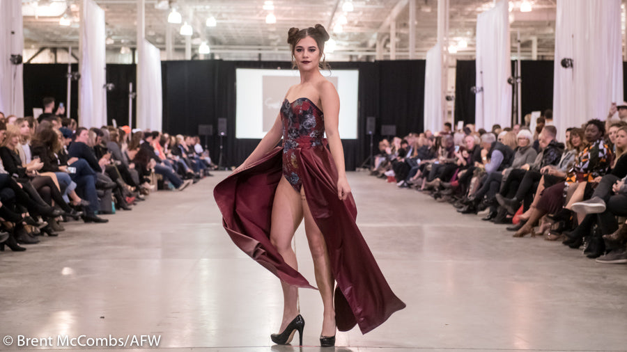 Emma Bradford wearing the glamorous corset dress in Atlantic Fashion Week's 12th season for East Coast Couture