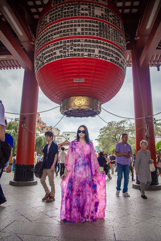 LeeAnn Dussault of East Coast Couture wearing New Brunswick designer flowy silk caftan in Asakusa at Sensoji temple
