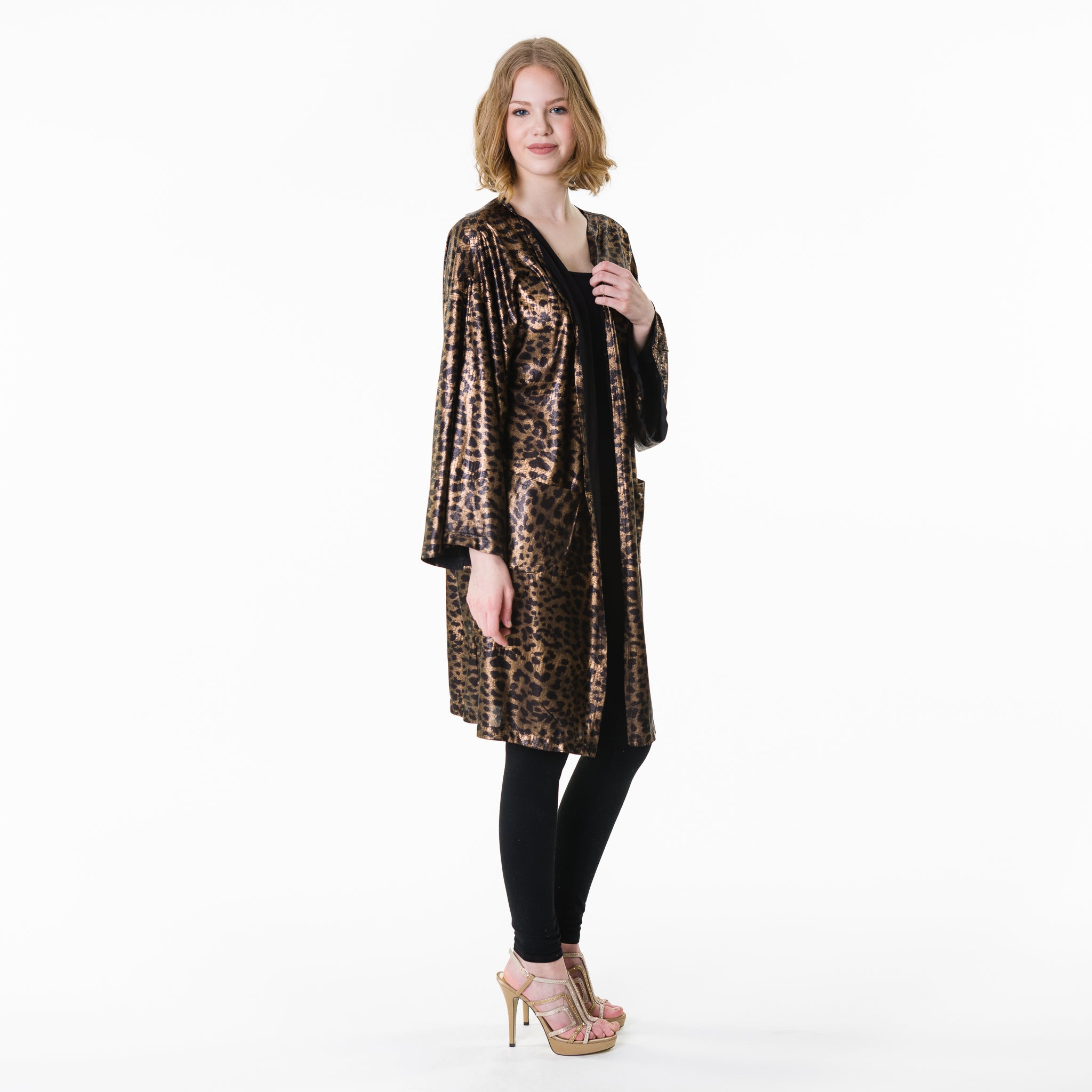 Polyester-nylon gold and black leopard print open wrap, with pockets. Shiny, flowing, breezy, and slightly sheer wrap.