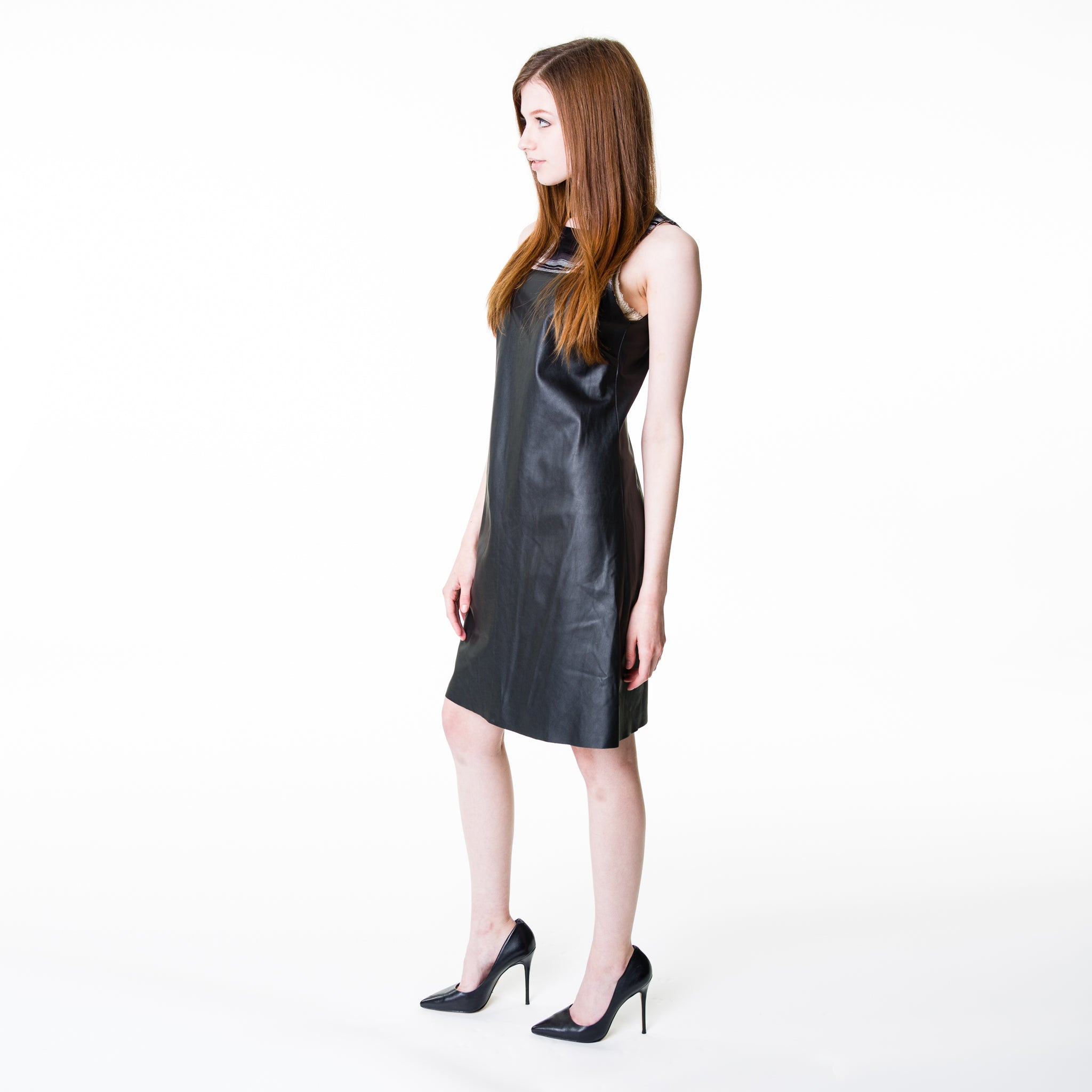 Faux leather shift with a top section made of polyester in a black and white tartan design.