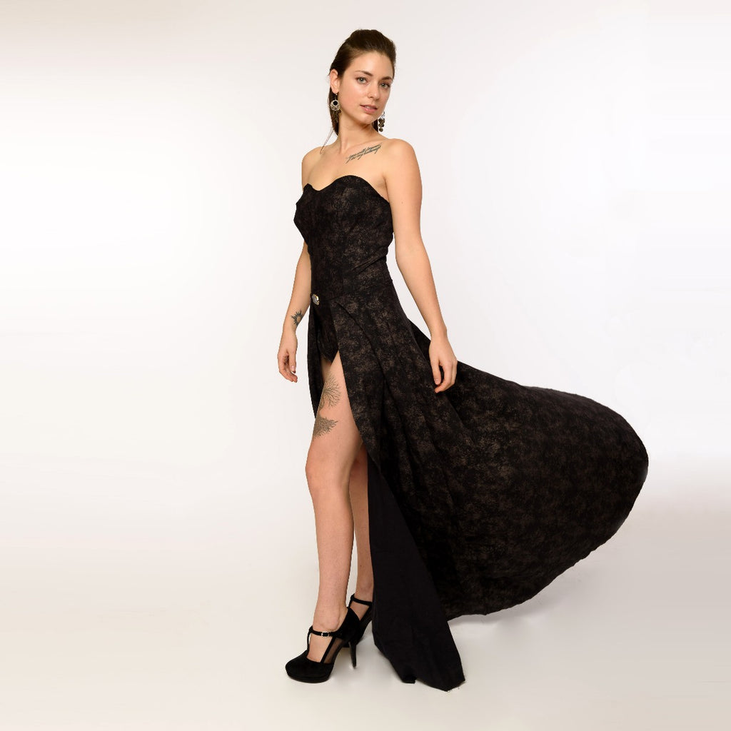 East Coast Couture's unique corset dress encrusted with a crystal gem stone, made in stretch black Jacquard polyester with bodysuit and flowing black skirt. Perfect for model's portfolio or worn as an evening gown.