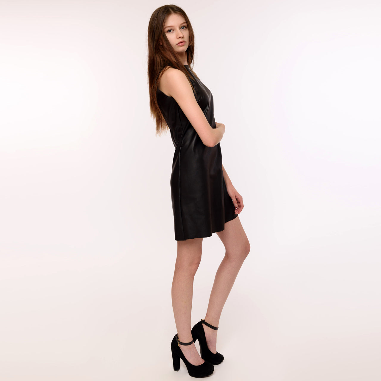 East Coast Couture presents this fine, vegan friendly, faux leather shift dress, perfect for modeling or an evening out.
