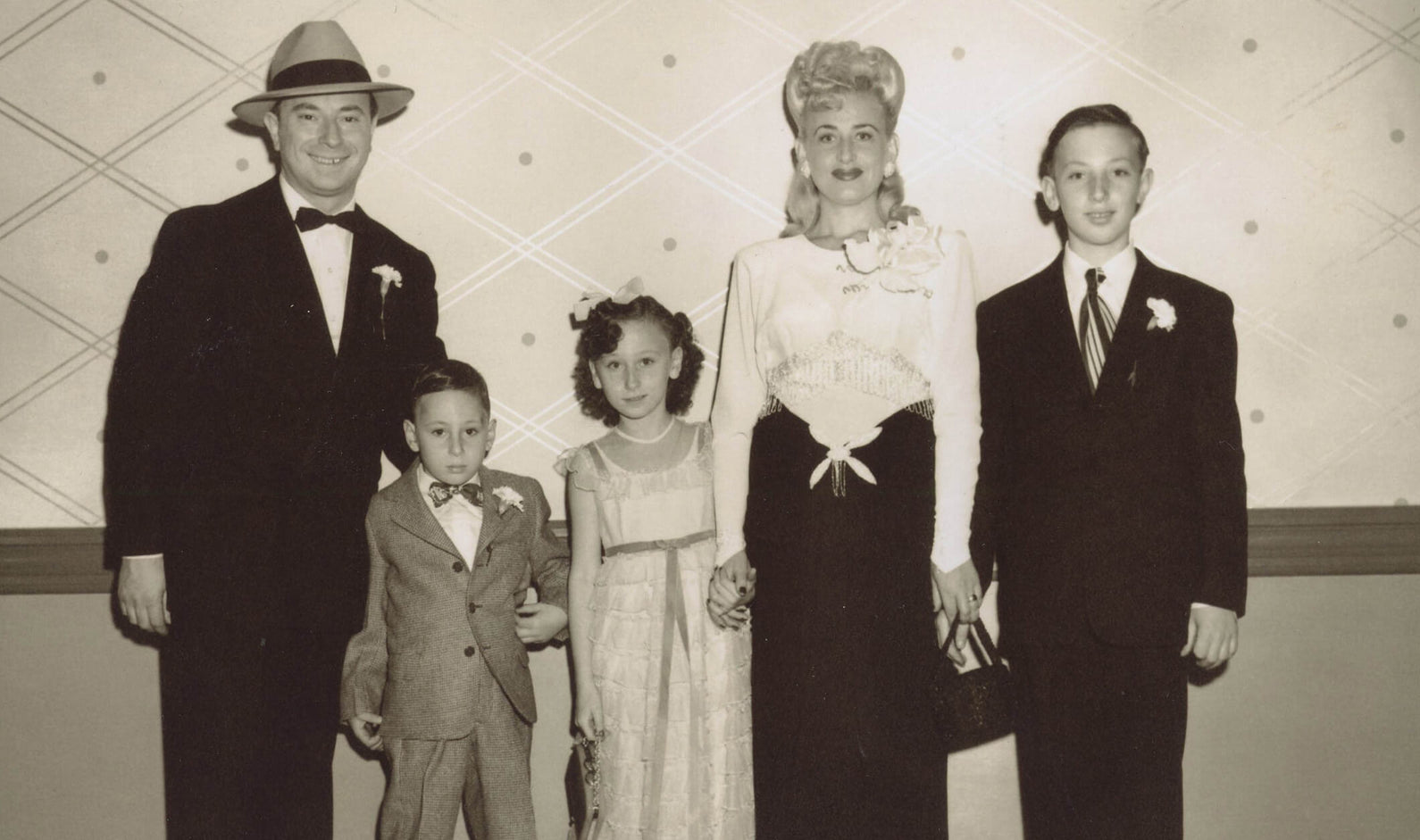 Sol and Grandma Sylvia with their three children, Danny, Beverly, and Joel, dressed in their finest to celebrate Joel's thirteenth birthday in 1948.