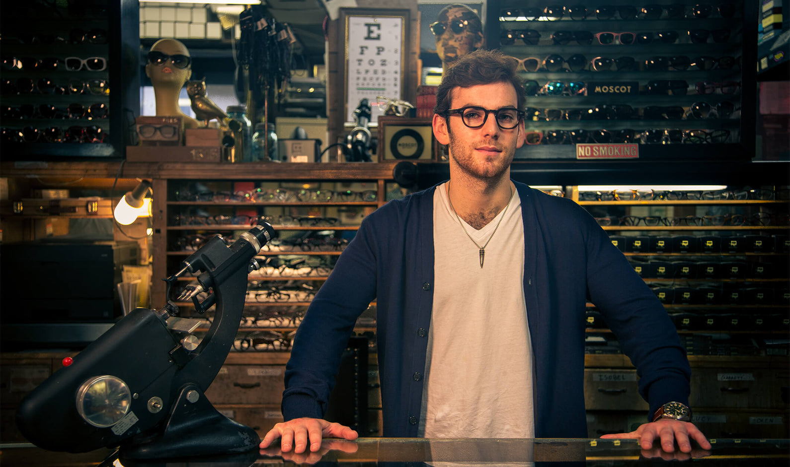 Man behind counter at Moscot store