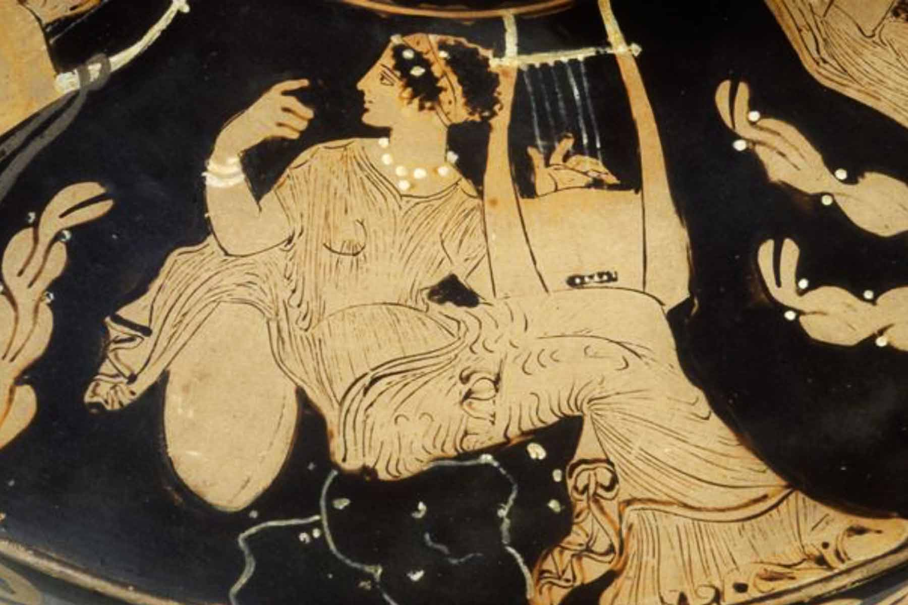 ic: Muse with kithara, detail of lid of Paestan red-figure pottery. Photograph by Maria Daniels, courtesy of the Musée du Louvre, January 1992.