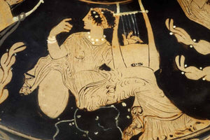 Muse with kithara, detail of lid of Paestan red-figure pottery. Photograph by Maria Daniels, courtesy of the Musée du Louvre, January 1992.