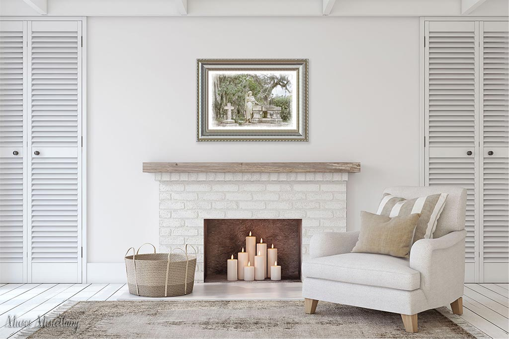 """Mockup of a 36x24"""" """"Caretaker"""" poster in an ornate silver frame hanging above a fireplace mantel with a cozy chair to one side. The image's muted earth tones complement the room's neutral decor."""