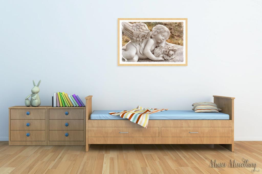 """Mockup of a 36x24"""" poster of """"Innocence"""" in a light wood frame, hanging in a child's bedroom. Wooden furniture and floors bring warmth to the space, while brightly colored accessories and a folk art rabbit add whimsy."""