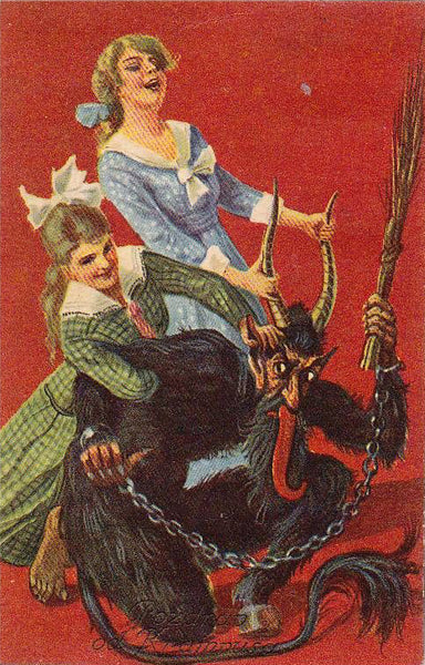 One young lady grabs Krampus by the horns while another wrestles him
