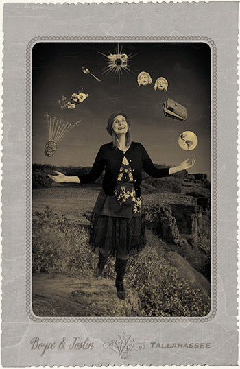 Cabinet card of Karen Joslin as The Fool, juggling an ancient lyre, flowers, an antique spoon, a vintage camera, comedy/tragedy masks, a stack of books, and a globe.