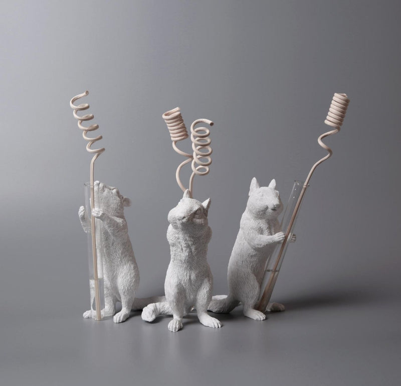 Squirrel Ornaments by Decorative Vase