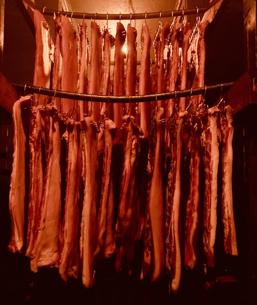 Hickory Bacon hanging in our smokehouse