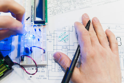 Working on electronics project using schematics