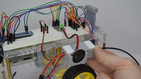 Speaker mounted to side of robot