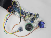 Breadboard circuit including speaker and accelerometer