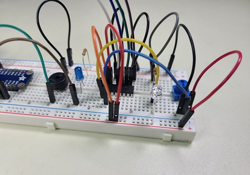 Raspberry Pi Python Breadboard Circuit with Piezo Speaker, Phototransistor, and Potentiometer