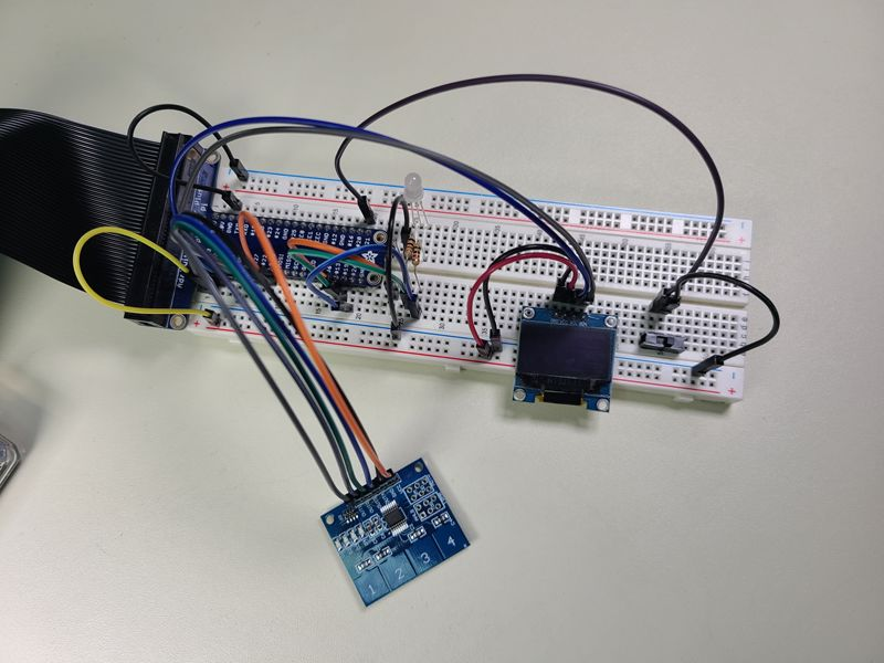 Breadboard Raspberry Pi Circuit Including Capacative Touch Sensor and OLED Screen Python Code