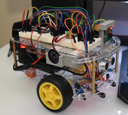 Side view of robot sitting on desk