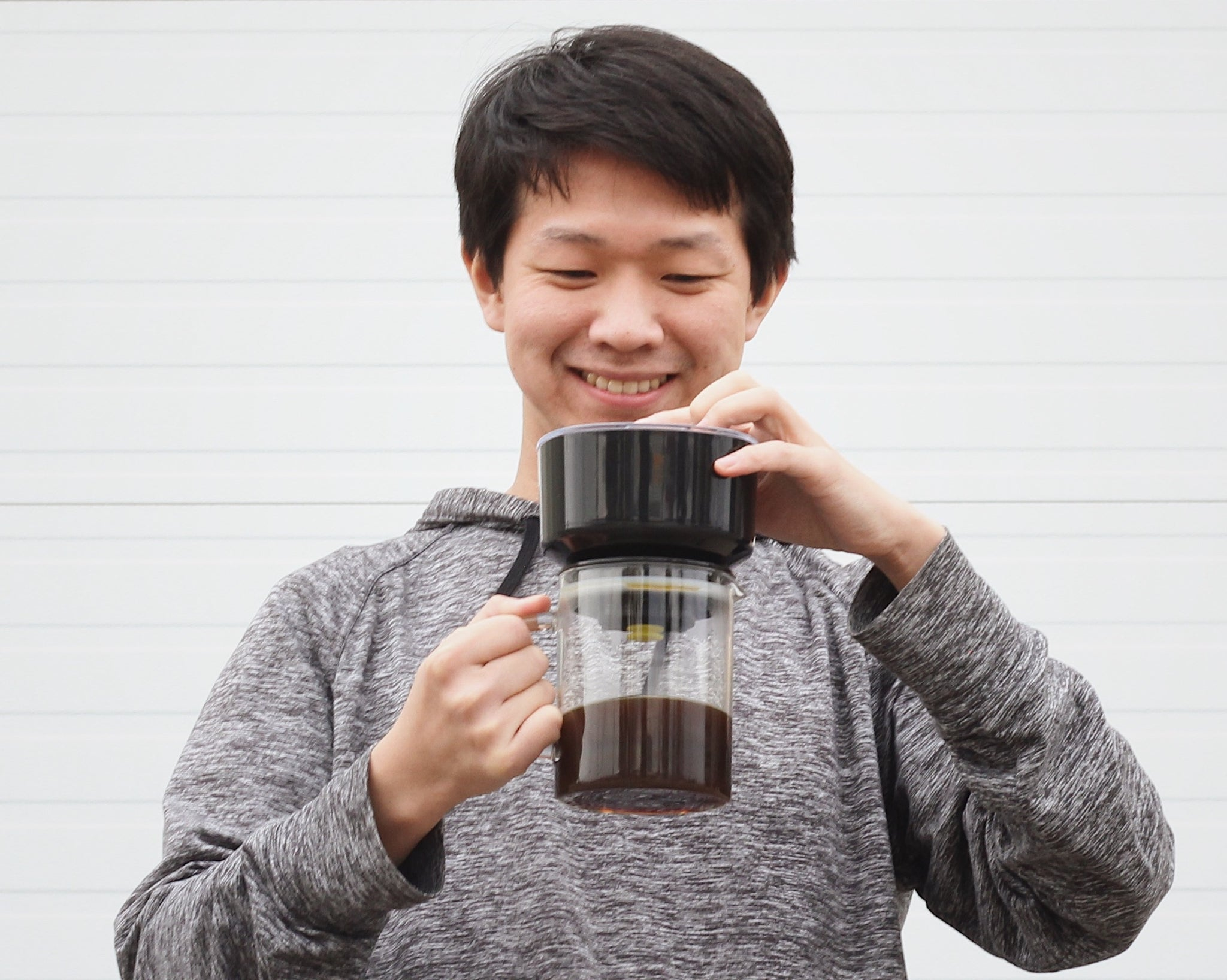 David Kim smiling with the VacOne™ Air Brewer