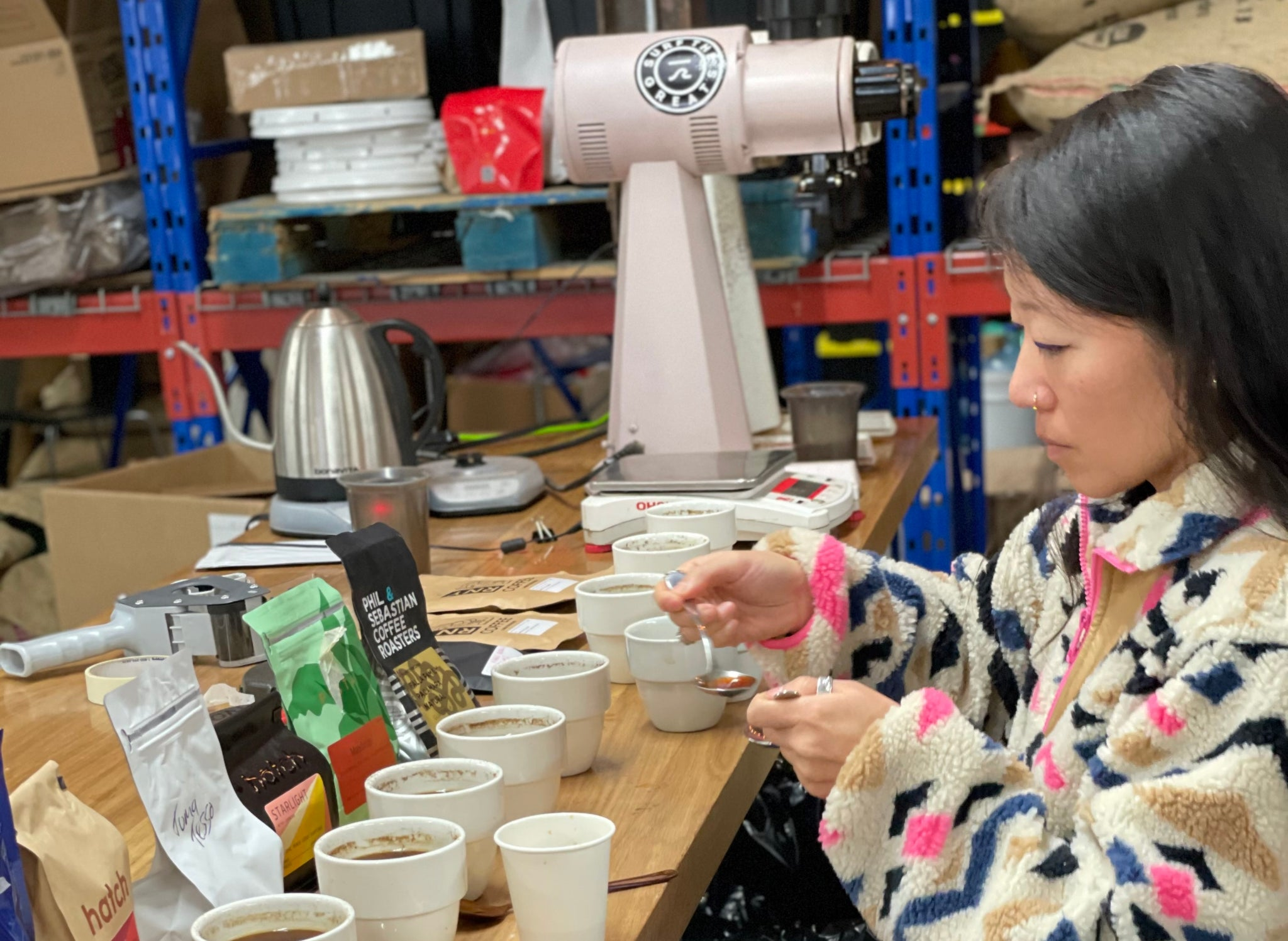 Melanie Leeson cupping coffee from different roasters