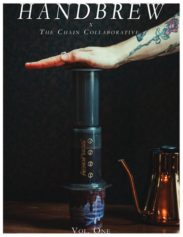 Pressing an Aeropress on the cover of Handbrew Publication