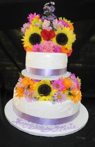 Lavender and White Birthday Cake with Fresh Flowers on Top - B0558