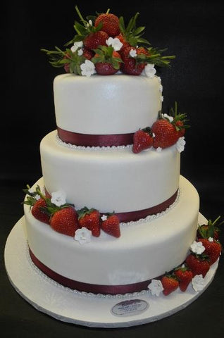 fresh strawberries, white cake, fruit blossoms