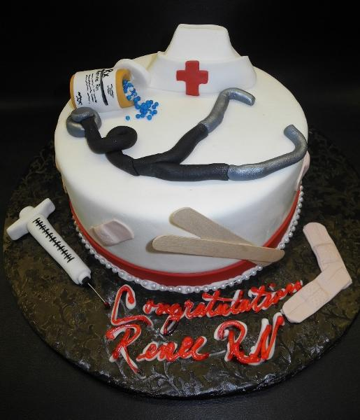 Nurse's Fondant Cake with Edible Nursing Tools, pills, syringe, band-aid, stethoscope,