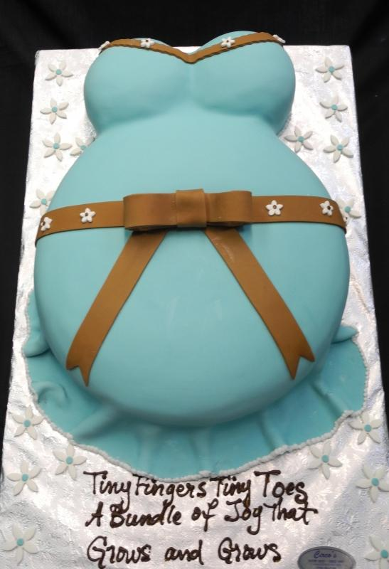 White Dress with Blue Brown Fondant Belly Cake for Baby Shower