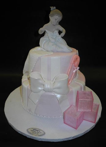 Pink and White Baby Shower Cake with Porcelain Ornament