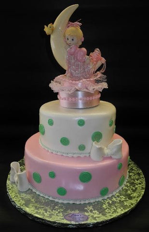 Pink, Green, and White Baby Shower Fondant Cake with Baby Ornament on top
