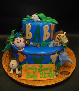 Safari Baby Shower Cake with Baby Sleeping and Edible Fondant Animals