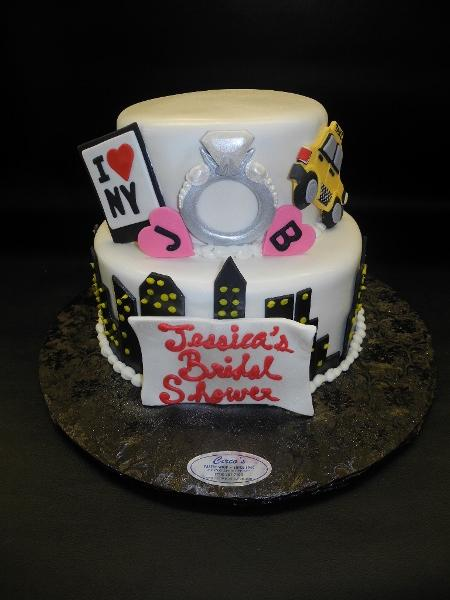 New York City Fondant Engagement Cake with edible fondant ring, taxi, and building cut outs