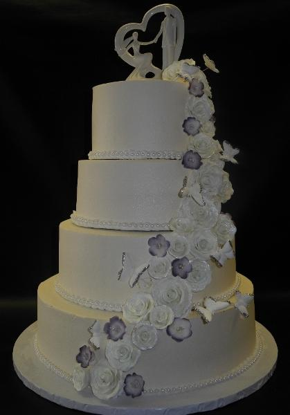 Whip Cream Wedding Cake with Flowers and Butterflies Cascading Down