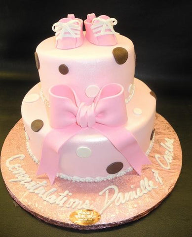 Pink and Brown Fondant Cake with Edible Booties On Top