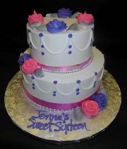 Whip Cream Sweet 16 Cake with buttercream flowers and cream dots