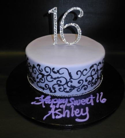 Sweet 16 Fondant Cake with black scroll work and diamond cake topper