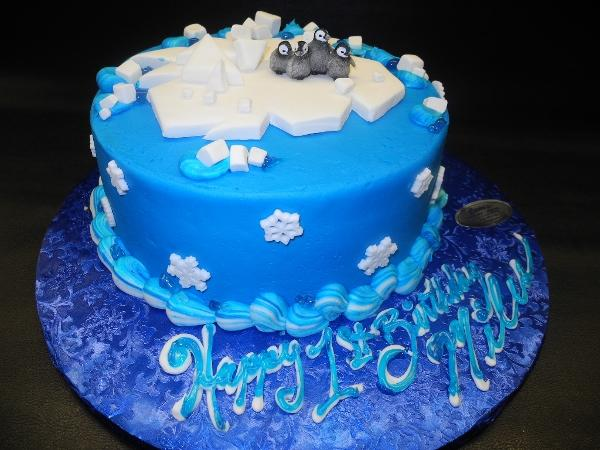 Penguins Icing Cake with Fondant Snowflakes