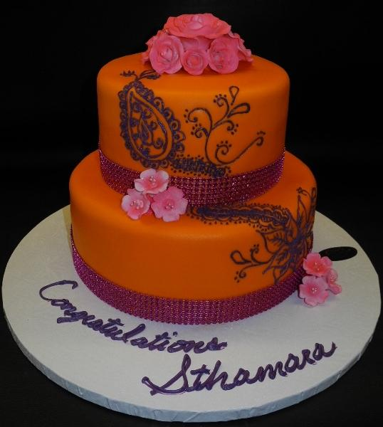 Orange Fondant Cake with  Purple Henna and Pink Flowers