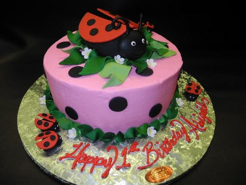 Lady Bug Pink Icing Cake with Fondant Dots and edible lady bugs
