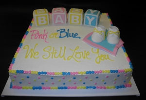 Gender reveal icing cake with fondant decoration