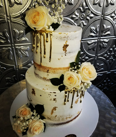 Naked cake with Gold embellishments and fresh flowers W195