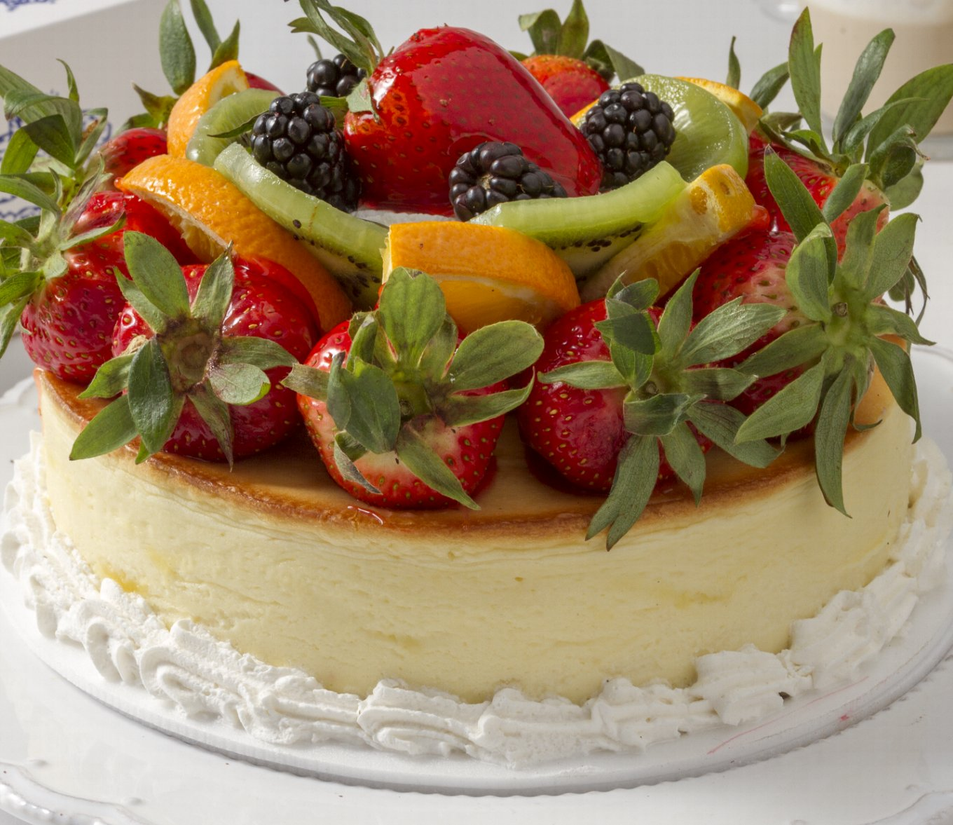 Cheesecake with mixed fruits. For Local Delivery or Curbside Pickup ONLY